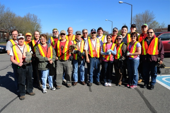 Holy Cross Council team prepares to pick up litter along the Airport Parkway