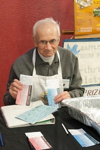 Member of the Knights of Columbus selling raffle tickets at a pancake breakfast