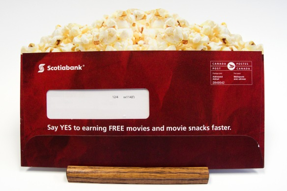 Scotiabank mailing, die-cut wndow envelope, popcorn on top